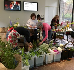 AfterBloom volunteers make May Day bouquets with an abundance of donated flowers.